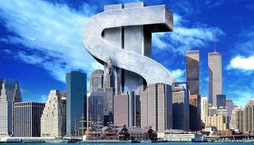 个别房企现债务危 房地产业遇发展